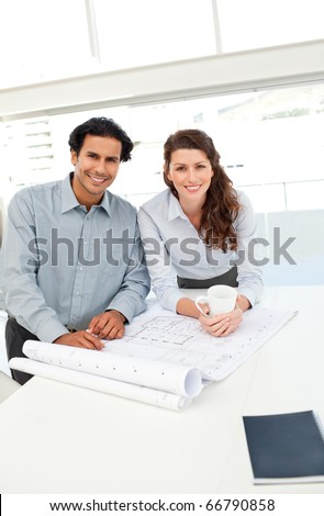 Portrait of happy architects working together on a new project - stock photo