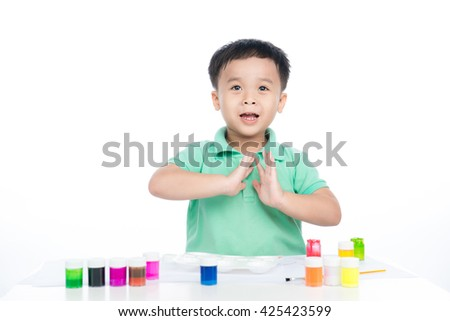 Portrait of happy asian boy holding brush drawing. shooting in the studio on white background. - stock photo