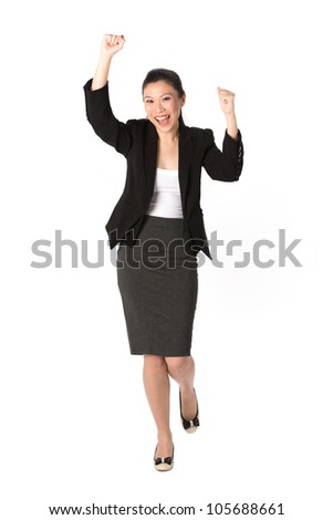 Portrait of happy Asian woman celebrating with her arms in the air.  Isolated on a white background. - stock photo