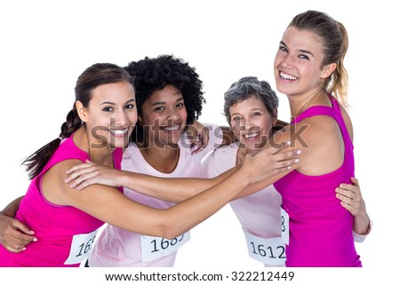 Portrait of happy athletes with arms around while standing against white background
