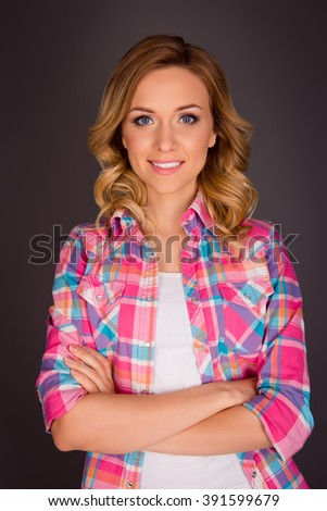 Portrait of happy attractive blonde posing with crossed hands