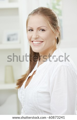 Portrait of happy attractive student girl smiling at home.