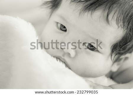 Portrait of happy baby on the bed - stock photo