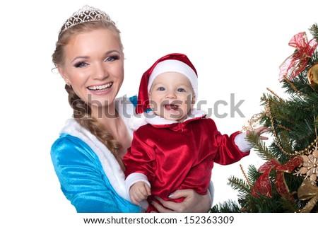 Portrait of happy baby-Santa and mom-Snow Maiden - stock photo