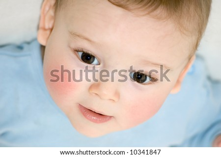 Portrait of happy baby with big brown eyes