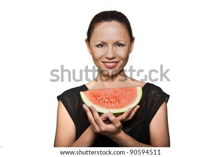 Portrait of happy beautiful Asian woman holding watermelon in studio isolated on white background - stock photo