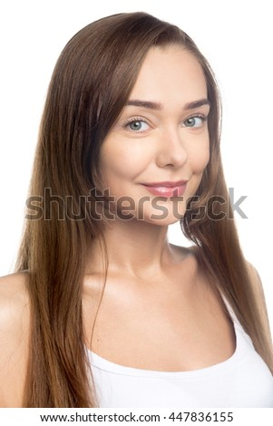 Portrait of happy beautiful attractive Caucasian young woman with long hair posing against white background. Headshot of smiling cheerful girl wearing casual closing. Studio vertical shot. Close-up - stock photo