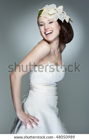 portrait of happy beautiful bride against grey background
