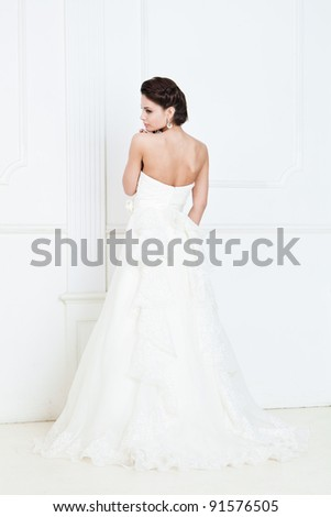 Portrait of happy beautiful bride against white background - stock photo
