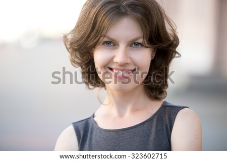 Portrait of happy beautiful business woman posing on the street in summer, friendly smiling, looking at camera with cheerful confident expression - stock photo