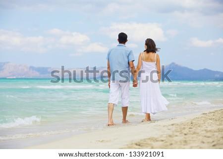 Portrait Of Happy Beautiful Couple Enjoying At Beach - stock photo