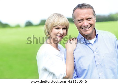 Portrait of happy beautiful couple on nature. - stock photo