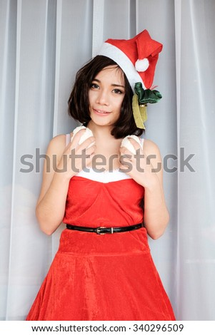 Portrait of Happy beautiful girl wearing Santa Claus clothes and headphones - stock photo