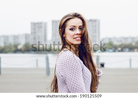 Portrait of happy beautiful smiling woman on urban background