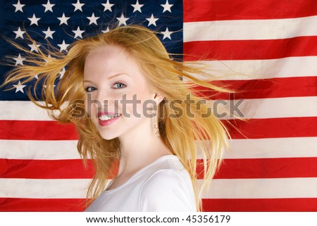 Portrait of happy beautiful teen girl against american flag
