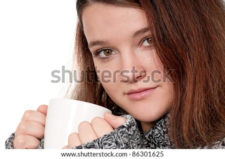 Portrait of happy beautiful teenage girl holding cup of hot coffee or tea