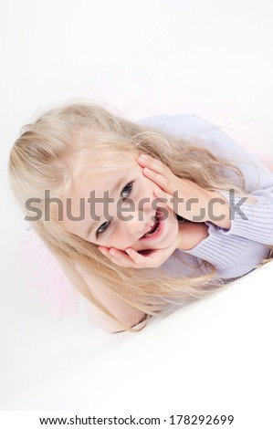Portrait of happy blond little girl - stock photo