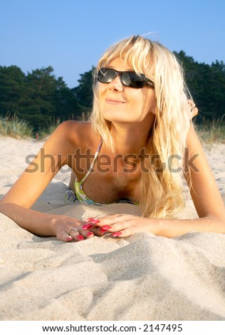 portrait of happy blond relaxing at the beach - stock photo