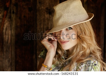 Portrait of Happy Blonde Woman with Hat - stock photo