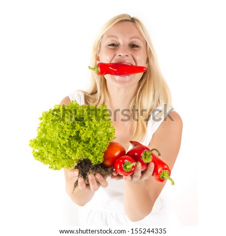 Portrait of happy blonde woman with vegetable. - stock photo