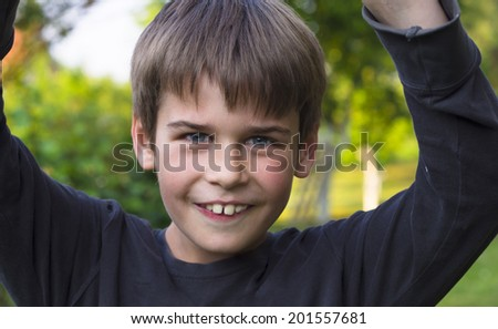 portrait of happy boy in the park - stock photo