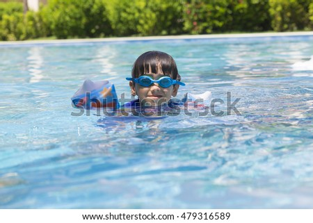 Portrait of Happy Boy in the Swimming Pool