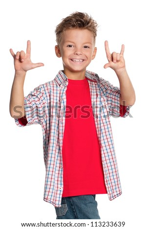 Portrait of happy boy showing rock and roll sign isolated on white background