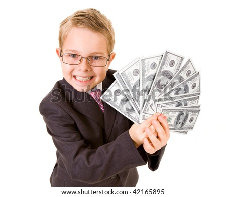 Portrait of happy boy with dollar bills looking at camera - stock photo