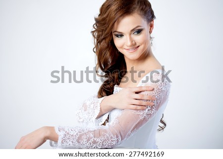 Portrait of happy bride in wedding dress, white background - stock photo