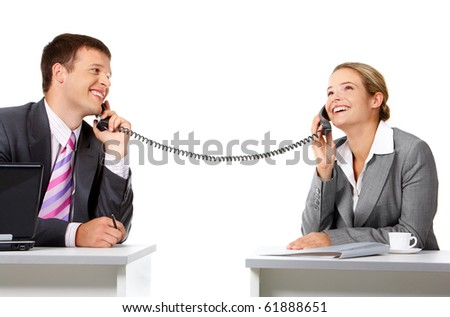 Portrait of happy business partners speaking on the telephone - stock photo