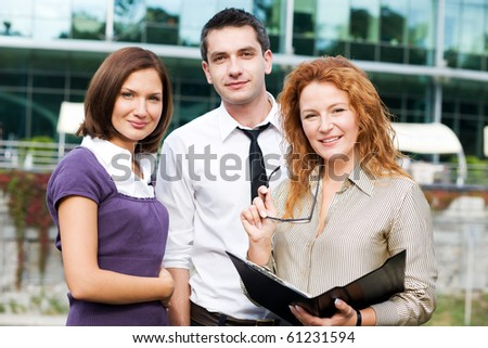 Portrait of happy business people staying outdoor and looking at the camera. People ready to cooperate with any business company. - stock photo