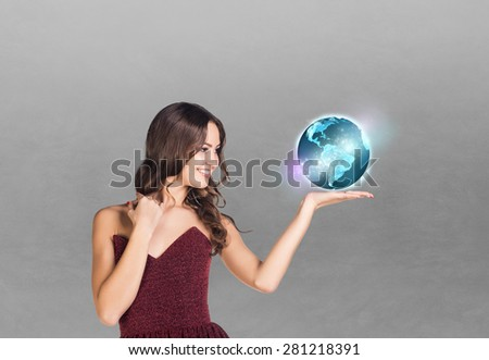 Portrait of happy business woman on grey background - stock photo