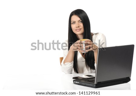 Portrait of happy business woman with a laptop - stock photo