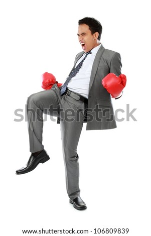 portrait of happy businessman with boxing glove. success concept