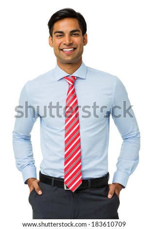 Portrait of happy businessman with hands in pockets standing against white background. Vertical shot. - stock photo