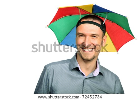 Portrait of  happy businessman with rainbow hat umbrella on head