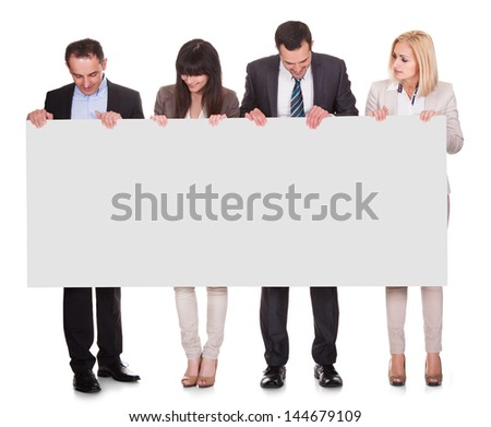 Portrait Of Happy Businesspeople Group Holding Placard Over White Background - stock photo