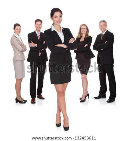 Portrait of happy businesswoman and her team. Isolated on white