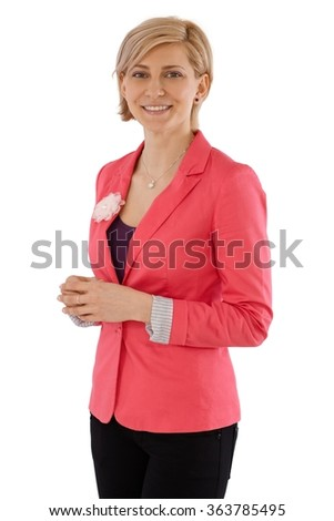 Portrait of happy businesswoman smiling, looking at camera. - stock photo