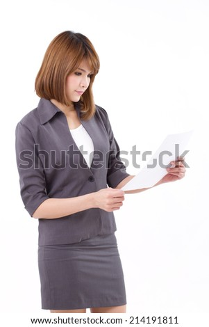 portrait of happy, calm, cool, confident businesswoman looking at document, isolated white background