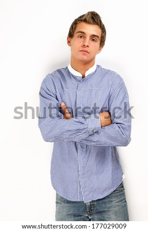 Portrait of happy casual young man standing with arms crossed, Isolated on white background - stock photo