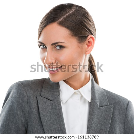 Portrait of happy Caucasian business woman standing over white background - stock photo