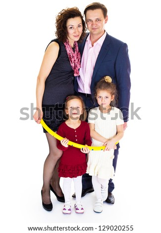 Portrait of happy Caucasian family smiling together on white background