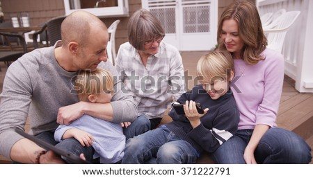 Portrait of happy caucasian family spending time together outdoors. - stock photo