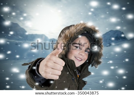 portrait of happy child in the snow - stock photo