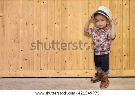 Portrait of happy child on wood texture. background old panels. Floor surface - stock photo