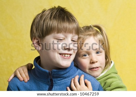 Portrait of happy children on a yellow background