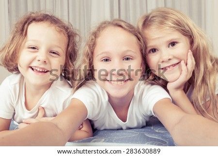 Portrait of happy children which are lying on the floor in the house.The concept of a brother and sister forever. - stock photo