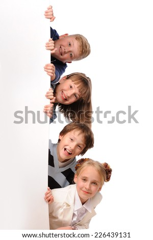 Portrait of happy children with white blank isolated on white background  - stock photo