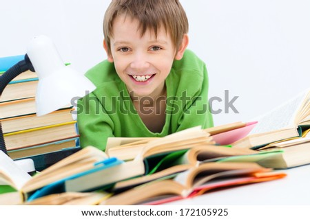 Portrait of happy clever boy reading book - stock photo
